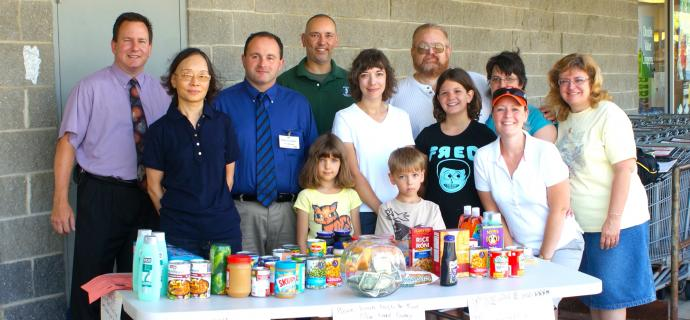 The Kiwanis Club of Mt. Olive gathering food donations for needy family in the township.